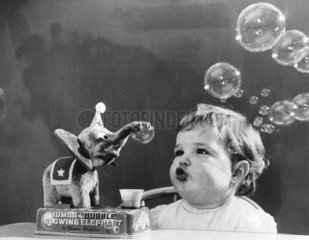 Jayne Fincher and her new toy elephant  1 December 1959.