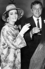 Elizabeth Taylor and Richard Burton at a wedding  August 1963.