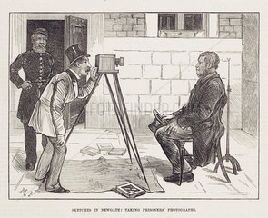 Photographer taking prisoner's photograph  19th century.