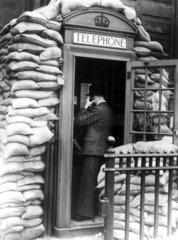 Telephone kiosk protected by sandbags  26 September 1939.