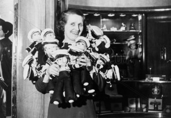 Woman holding doll sailors on-board the 'Queen Mary'  28 May 1936.
