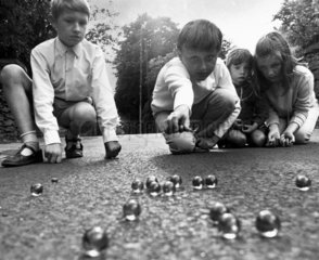 Children playing marbles  1970.