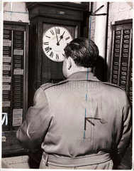 A worker clocking on  1959.