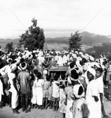Tea plantation workers receiving their mont