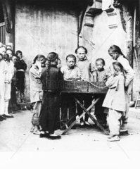 Chinese children listening to a gramophone