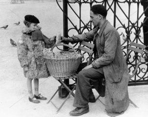 Peanut seller  Paris  c 1930s. Photograph b