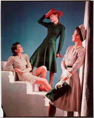 Three women modelling the latest fashions  c 1940s.
