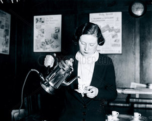 Using a new electric coffee percolator  2 December 1932.