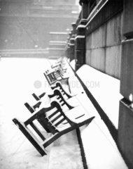 Benches in snowy Trafalgar Square  London