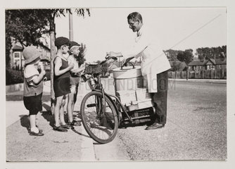 Ice cream seller on a bicycle  c 1925.