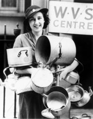 Woman with aluminium pans  World War Two  10 July 1940.