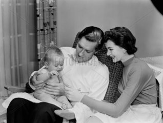 Young couple and baby  1956