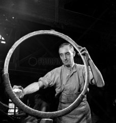 Studies in the Cannon Brewery a cooper chalks a ring for beer barrel  1947.