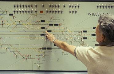 Signalman operating push buttons on illuminated track  December 1966.