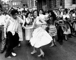 Dancing rock 'n' roll in the street  c 1950