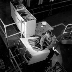 Production line worker with Hoovermatic twin tub washing machines  Merthyr.