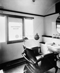 Hairdressing saloon inside a railway carriage  February 1948.