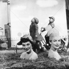 Women wearing flower hats  1950s.