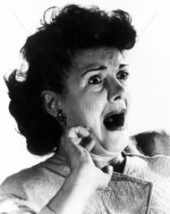 Woman gasping with terror  c 1940s.
