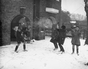 Children throwing snowballs  19 December 19