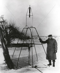 Robert H Goddard at first flight of a liquid propellant rocket  16 March 1926.