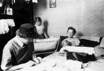 District nurse attending a sick child  November 1955.