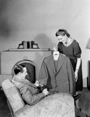 Woman showing a man a suit  1948.