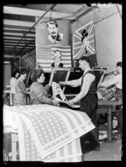 Factory workers making flags  1945.