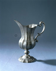 Fluted pewter jug  probably Italian  18th or 19th century.