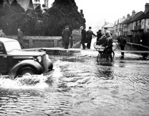 Flood water over the main Bath Road at Maid