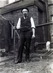 Man in back yard  c early 20th century.