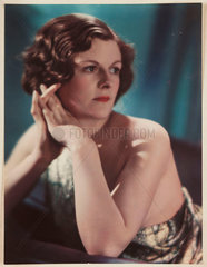 Woman wearing an evening dress posing for the camera  c 1940s.