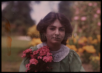 Girl with a bunch of flowers  1908.