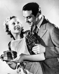 Couple with a cake  late 1930s.