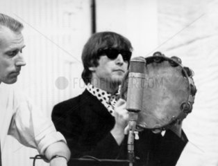 Beatle John Lennon with record producer George Martin  2 October 1964.