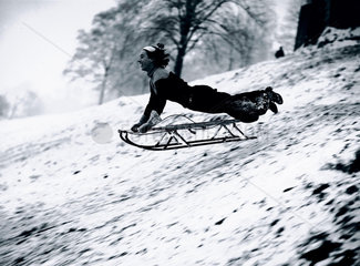 Tobogganing on Hampstead Heath  London  22 December 1938.