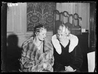 Two models displaying the latest hairdressing fashions  15 March 1933.