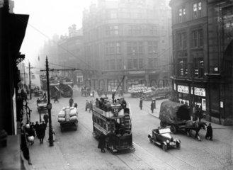 Trams running along Deansgate  Manchester