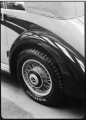 Detail of a motor car wheel with a Continental tyre  c 1934.