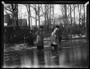 'Women Skating On Pond'  c 1900.