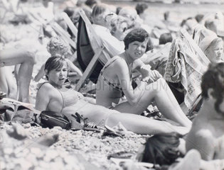 Young women sunbathing on Eastbourne beach  July 1976.
