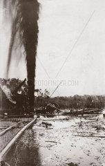 Oil gusher at Potrero  Mexico  1911.