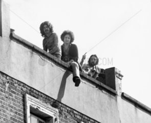 Squatters on a roof  September 1973.