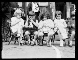 Schoolchildren drinking milk 1 October 1934.