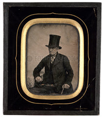 Old man wearing a top hat  c 1860.