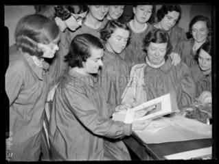 Girls admiring photograph of the Duchess of Kent  30th December 1937.