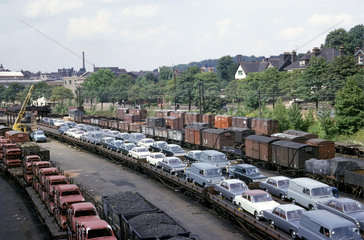 Cars on a freight train at Luton  Bedfordshire  1965.