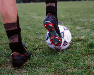A football boot about to strike a ball  October 2000.