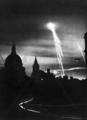 Bombs lighting the night sky over London  22 March 1944.