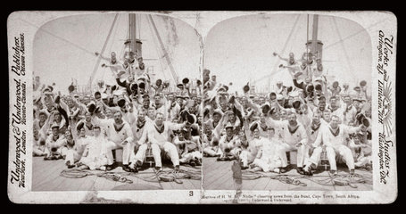 Marines from HMS Niobe cheering news from the front  Cape Town'  1900.